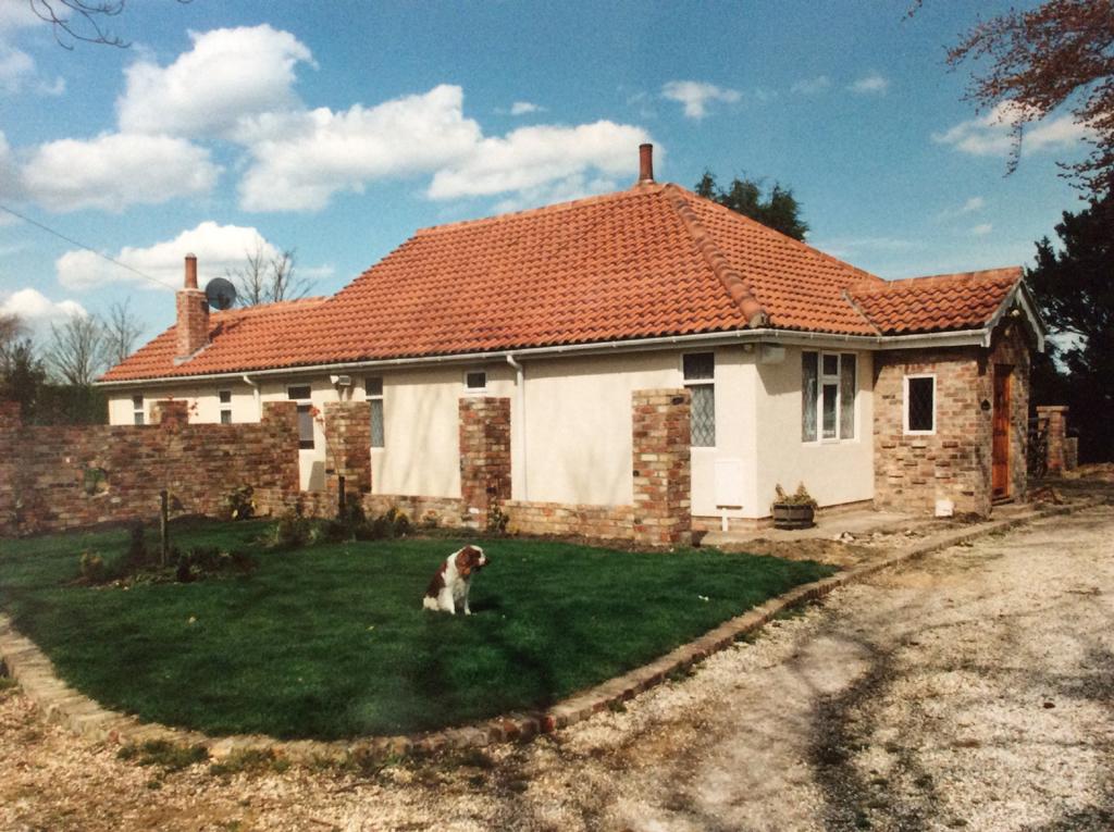 Garden design ideas - Walling (reclaimed bricks) paving and turfing