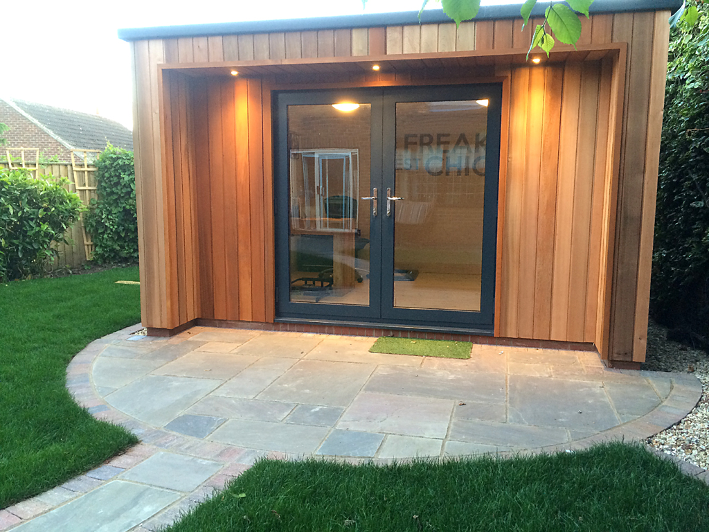 Garden design ideas - Garden room with paving, lighting and landscaping