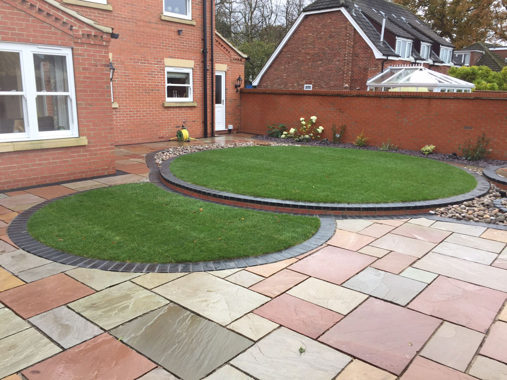 Garden design ideas - Turfing paving walls and low maintenance beds