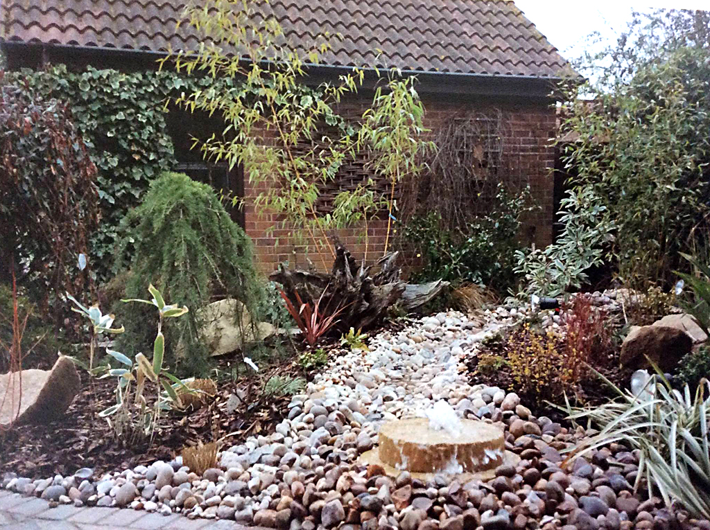 Mature water feature fountain millstone